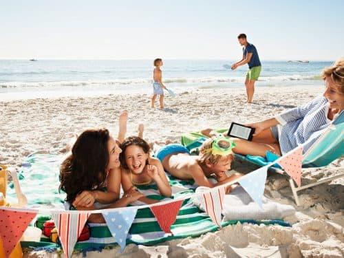 Family having fun on beach 1